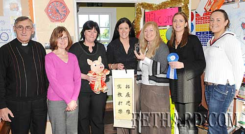 Teacher Kate O'Connell, photographed with staff members on her return from China.