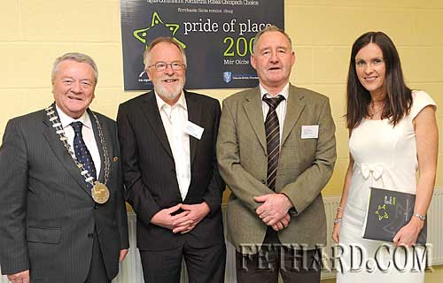 Clonmel Workmen's Boat Club members who represented South Tipperary County Council in the environmental section of the national Co-Operation Ireland 'Pride of Place' Awards Ceremony held in Cappoquin on Saturday 9th November. L to R: Cllr Tom Ambrose, Chairman South Tipperary County Council; Shay Hurley, Bernard Lennon, and Margo Hayes, Liaison Officer, Community & Enterprise, South Tipperary County Council.