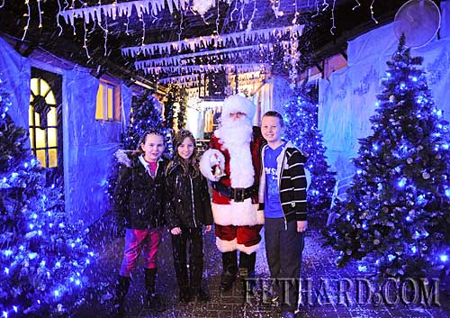 Santa Claus arriving at Lonergan's in Fethard where he will meet children on next Sunday afternoon from 2.30pm to 5pm. Photographed with Santa are Laura Stocksborough, Andrea Carroll and David Stocksborough.