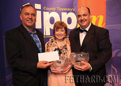 Overall winner of Tipp FM's Premier Star award, Laura Rice from Patrician Presentation Secondary School, Fethard, receiving her €1,000 cash prize from Pat Doheny, Premier Music Clonmel, and a Tipperary Crystal Trophy from Norman Morrissey, Tipp FM.
