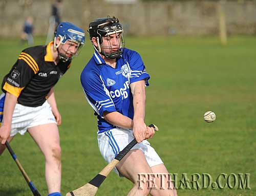 Christopher Sheehan (Fethard) hitting towards goal in the Intermediate Hurling League 'B' Round 1 game between Fethard and Arravale Rovers