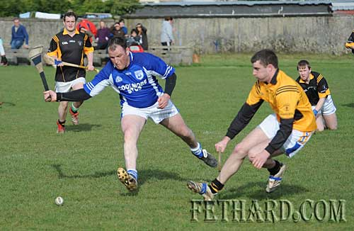 L to R: Tom Keane (Fethard) and Arravale Rover's goalkeeper Thomas Gleeson in the Intermediate Hurling League 'B' Round 1 game between Fethard and Arravale Rovers played in Fethard