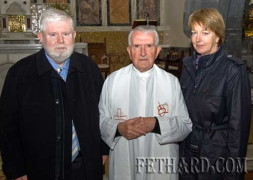 Fr. John Meagher with his nephew Sean Mc Govern and his wife Anne