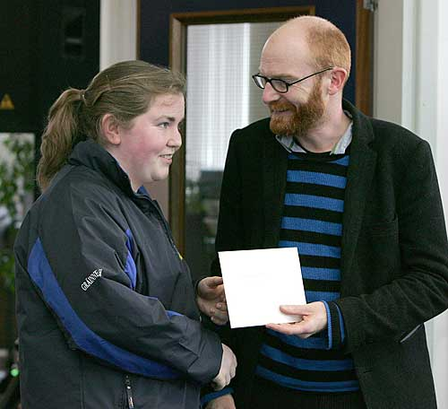 Gráinne Horan receiving her prize from Paul Young of the 'Cartoon Saloon'