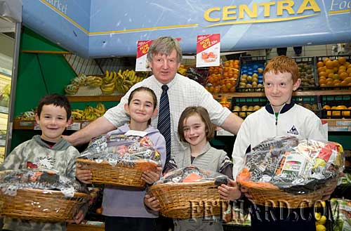 Winners in the Centra Halloween colouring competition photographed with Larry Kenny who presented the prizes. L to R: Cian Hennesssy, Carly Tobin, Kaylin O'Donnell and Larry Gleeson.
