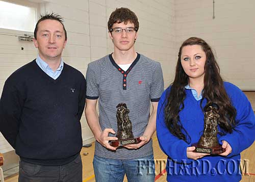 Mr Justin McGree (left) presenting Sports Person of the Year Awards to Darragh Dwyer and Bridget O'Reilly.