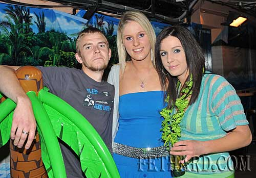 Photographed at Lonergan's 'Beach Party' last weekend were L to R: James Roche, Martina Ryall and Michelle Ryall.