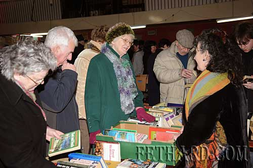 Pat Looby selling books at Fethard Historical Society stall to Agnes Evans.