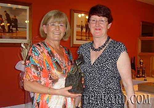 Player of the Year 2009 Carmel Condon (left) receiving her prize from Gemma Burke (President)