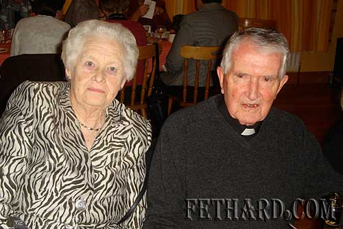 Photographed at Fethard Bridge Club Christmas Party are L to R: Bridie Lee and Fr. John Meagher OSA.