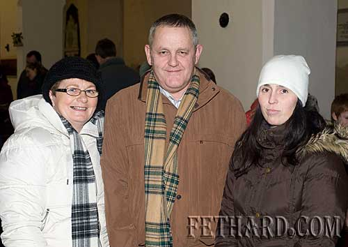 Photographed at the Annual Carol Service at Holy Trinity Church are L to R: Judy Doyle, Sean Doyle and Mia Treacy.