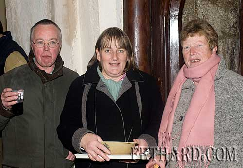 Photographed at the Annual Carol Service at Holy Trinity Church are L to R: Michael Kenrick, Heather Bailey and Mary Kenrick.