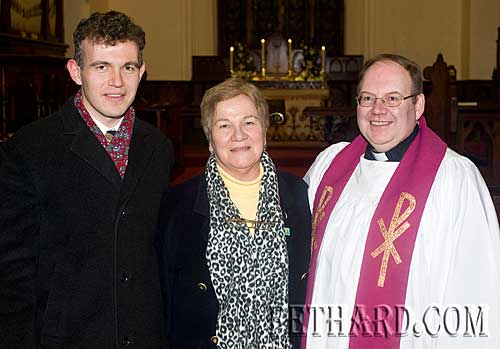 Photographed at the Annual Carol Service at Holy Trinity Church are L to R: Dr. David Butler, Peig Butler and Rev James Mulhall