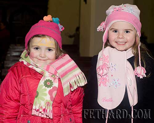 Photographed at the Annual Carol Service at Holy Trinity Church are L to R: Emma Hayes and Abbie Tillyer