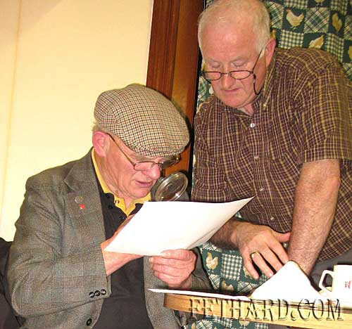 Local social historian Brendan O'Gorman from Mullinahone and William Lee from Loughcopple studying extracts from the 1911 Irish Census Record.