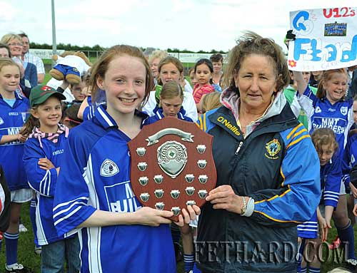 Fethard captain, Annie Prout, receiving the Ladies Under-12 County Plaque from County Board Representative, Biddy Ryan, following Fethard's win over Clonmel Og in the County Final played at New Inn last weekend.