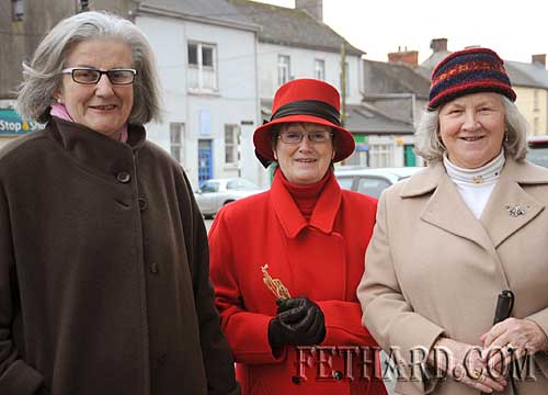 On their way home from Mass on Christmas day are L to R: Geraldine Maher, Berna Morrissey and Anna Henehan.