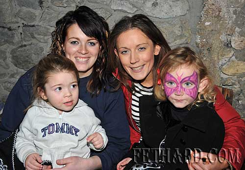 Photographed at the Christmas Party at The Castle Inn are L to R: Rebecca Ryan holding baby Chloe Ryan, and Samantha Brennan holding baby Alisha Brennan.