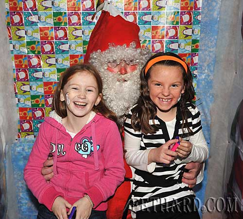 Visiting Santa at the Christmas Party at The Castle Inn Fethard are L to R: Holly Keating and Megan Earls
