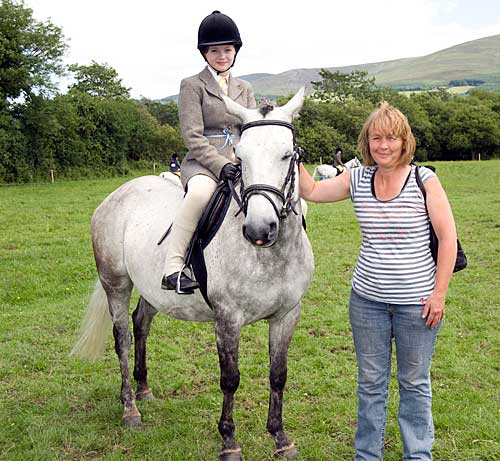 Ciara Flood on her pony 'Daisy Pony', led by Loretto Flood at Killusty Show