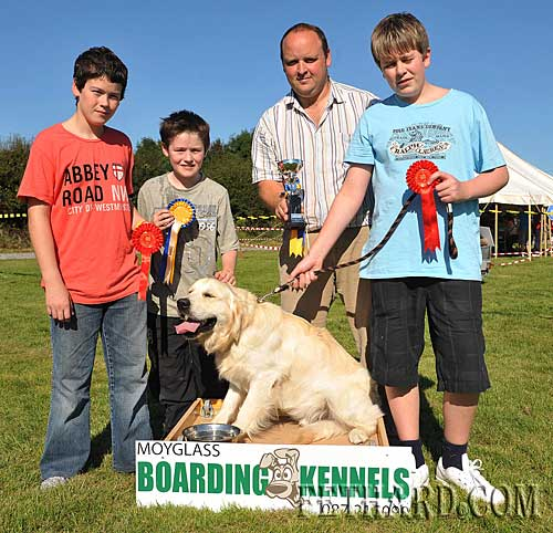 John Smullen, Moyglass Boarding Kennels, presenting the 'Best in Show' prize to Luke Grant and his dog 'Sammy' at Fethard Community Field Day Dog Show. L to R: Colm Grant, Luke Grant, John Smullen and Andrew McGuire