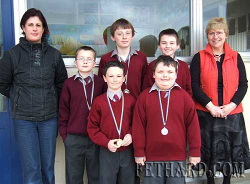 Community Games Area Medallists from St Patricks Boys School Fethard. Back L to R: Sonia Bonelli, Community Games, Harry Butler (Bronze U-12), Tommy Anglim (Gold U-14), Cormac Horan (Silver U-14), Mrs Patricia Treacy (Principal St Patricks Boys School). Front L to R: Conor Harrington (Gold U-10) and Gavin Mullally (Silver U-10). Conor Gavin Tommy and Cormac will contest the County Final in Gortnahoe on Saturday next 4th April.
