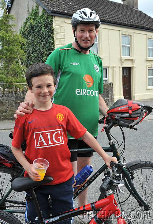 Father and son, Liam and Conor Harrington photographed in Moyglass while taking part in the sponsored cycle in aid of Fethard Youth Centre last Sunday.