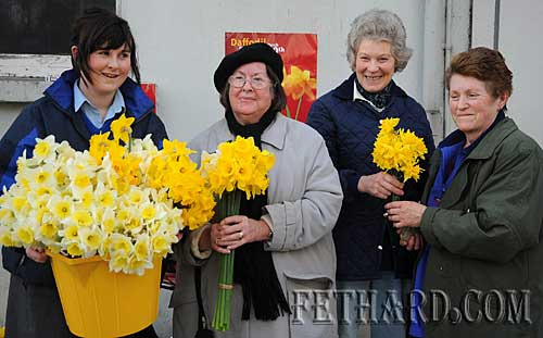 Buying daffodils from transition year student, Kelly Fogarty, outside Fethard Post Office on 'Daffodil Day' are L to R: Kelly Fogarty (Fethard Patrician Presentation Secondary School TY student), Mrs Peg Sharpe, Mrs Rosemary Ponsonby and Mrs Mary Connors.