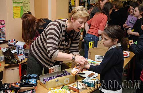 Ms Maureen Maher busy serving at the Fairtrade sweets and chocolate stall