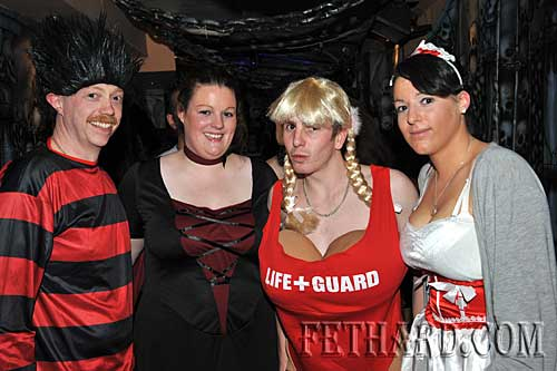 At the Halloween Party in Lonergans were L to R: Tom Behan, Mary Meagher, Eoin Maher and Alice Meagher.