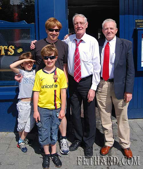 Mark Lonergan (left), photographed home from San Francisco on holidays with his two sons Tadhg and Cian, and Fethard locals, Jim Carroll and Johnny Murphy (right). The photograph was taken outside Mark's previous family home, Lonergans Pub on The Square.