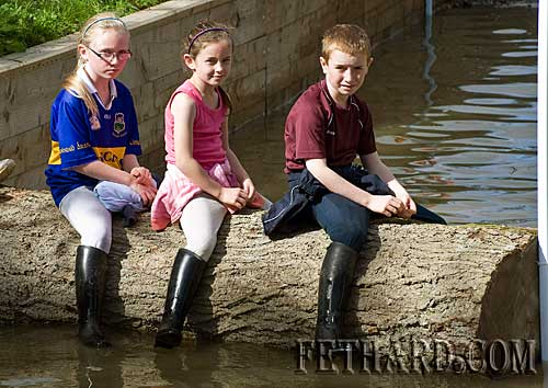 Enjoying the Horse Trials at Grove last Sunday are L to R: sisters Megan and Leah Coen with their cousin Luke Coen.