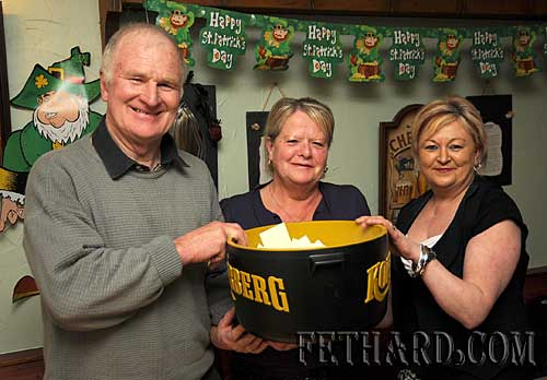 Making the draw at the Fethard Hospice Support Group's St. Patrick's Day raffle held at The Castle Inn were L to R: Denis Burke, Kathleen Coen and Irene Sharpe.