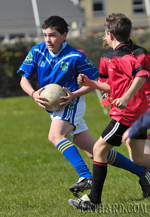 Fethard captain Adam Fitzgerald steps past Ballyporeen's defence to score his side's only goal in the second half of the under-12 football game against Ballyporeen