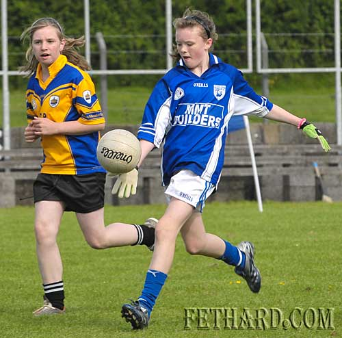 Fethard's Katie Butler shoots past Clonmel Óg to score in the county final.