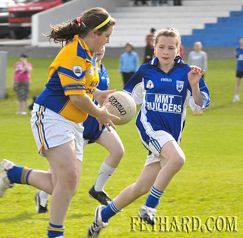 Fethard's Jessie McCarthy moves in to challenge for the ball.
