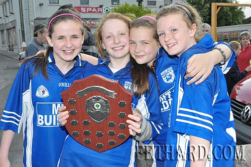 Four proud Fethard girls celebrate with county trophy. L to R: Laura Ryan, Annie Prout, Jessie McCarthy and Katie Butler.