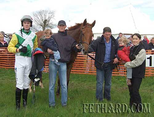 'Court Red Handed' who provided local trainer P.J. Colville with thefirst leg of a treble at Tipperary Hunt Point to Point at Lisronagh last weekend.  L to R: Robbie McNamara (rider),P.J. Colville (trainer) with William Colville, Donal, Barry, Grainne and Patrick Colville.