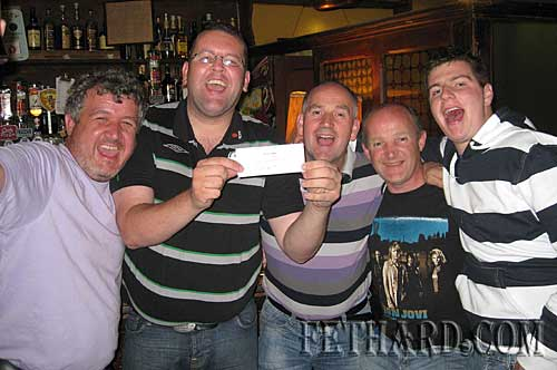 Celebrating a €1,000 lucky jackpot win in the Rehab Lotteries at McCarthys last weekend are L to R: Liam Kelly, Jason McKeown, Frankie O'Donovan, Richard Cummins and Aaron O'Donovan.