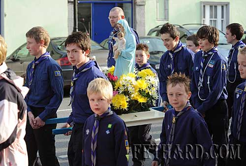 Fethard Boy Scouts carrying the statue of Our Blessed Lady at the May Procession on Sunday last from Fethard Parish Church to the Augustinian Abbey.