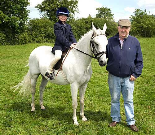Megan Coen on Topper with her grandfather Pat Carroll at Killusty Show 2009