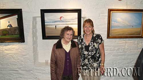 Leish & Dilly Fogarty pictured with some of Joe's paintings exhibited on the wall behind.