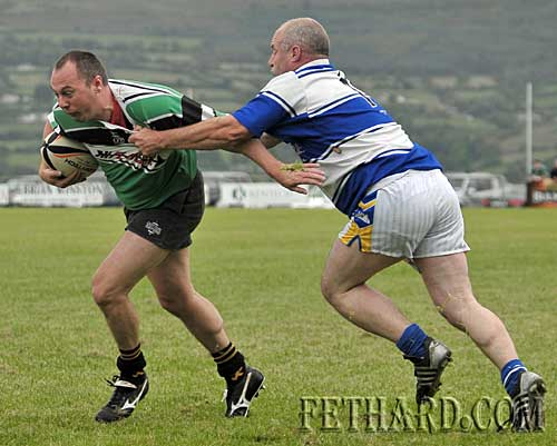 Playing his first game of rugby, Tom Anglim gets to grips with the game to stem another Clonmel attack