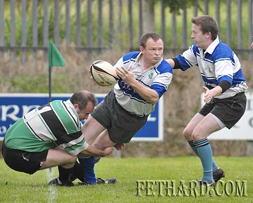 Anthony Wall looks to offload the ball to Martin Murphy before being taken into touch.