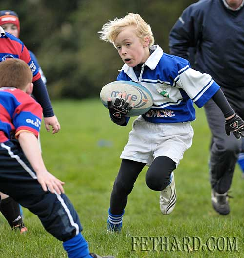 Christian Casey side-steps the defence on his way to a try in Fethard's Under-10 rugby victory over Carrick-on-Suir on Sunday 29 March.