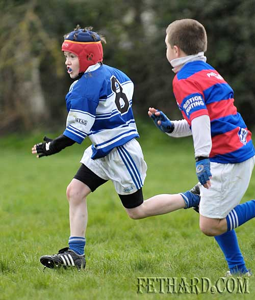 Luke Grant's pace keeps him clear of Carrick's defence as he sprints for the line to score another try for Fethard in their under-10 match played in Fethard last weekend
