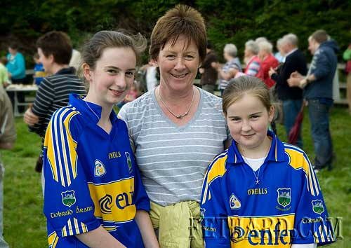 Michelle, Mary and Orla Walsh keep the Tipperary Team in mind on Slievenamon on Sunday last, August 16th.