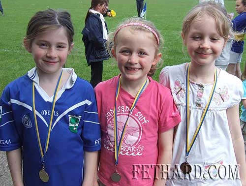 Winners in the Girls U8 60m race at Fethard Area Sports L to R: Lucy Spillane (gold), Anika O'Connor (silver) and Laura Kiely (gold).