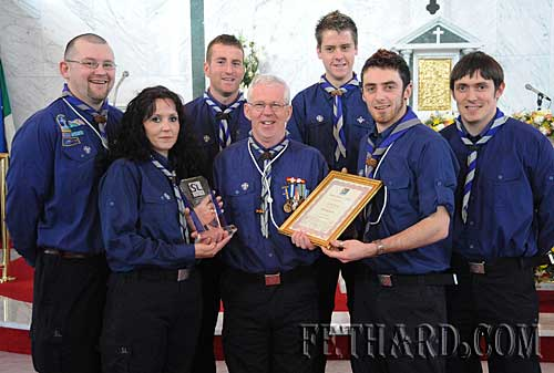 Scout leader Bobby Phelan receiving a surprise presentation at St. Patrick's Day Mass in Fethard to mark his long time service to scouting in Fethard. L to R: John Cloonan (Cub Section Leader), Michelle Hammond (Scout Assistant), Philip O'Donnell (Scout Leader), Bobby Phelan (Group Leader), Dermot Culligan (Scout Leader), Mike McCarthy (Scout Leader) and John McCarthy (Scout Leader).