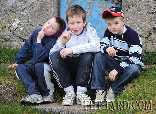 Watching the Under-21 football match between Commercial's and Killenaule in Fethard are L to R: Dean Dorney, Eoin O'Donovan and Dean Kenny.